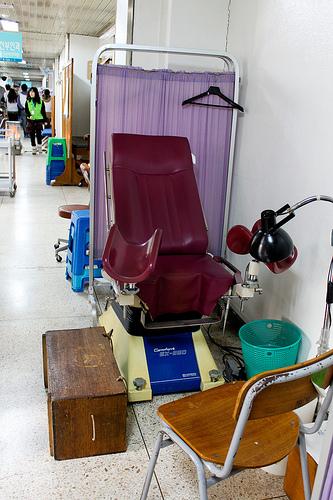 An exam chair in a hallway.