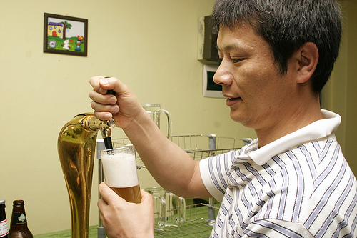 Mr. Kim standing at his home built tap.